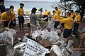 US Navy 101212-N-5758H-006 Members of the U.S. 7th Fleet Band, Far East Edition, separate trash they collected from Painagama Beach.jpg