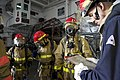 US Navy 110623-N-ZC343-002 Sailors aboard USS Bonhomme Richard (LHD 6) take part in a main space fire drill.jpg
