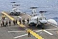 US Navy 111002-N-KM175-161 Marines assigned to the 31st Marine Expeditionary Unit (31st MEU) board CH-46E Sea Knight helicopters assigned to Marine.jpg