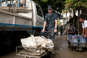 US Navy 120201-N-OH194-013 Ensign Joel Reed, assigned to the guided-missile destroyer USS Wayne E. Meyer (DDG 108), removes construction debris dur.jpg