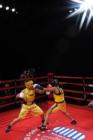 US Navy 120201-N-ZZ999-444 Navy Information Technician 2nd Class Nicole Saunders jabs Spc. Dianeya Nodarse their bout in the finals of the 2012 Arm.jpg
