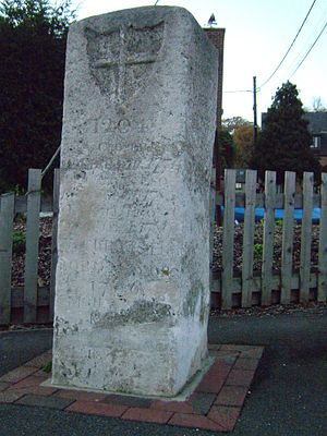 Upnor - The Older London Stone standing in front of the fence of the Arethusa Venture Centre.