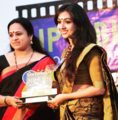 Utthara Unni Receiving Best Dancer Award 2017.png