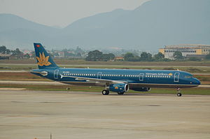Noi Bai International Airport - Vietnam Airlines Airbus A321-200 taxiing at Noi Bai International Airport