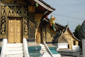 Literature of Laos - Luang Prabang, Wat Xieng Thong, an ornate Ho or library is in the background.