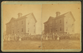 View of unidentified students and teachers in front of school, by Alden, A. E., 1837-.png