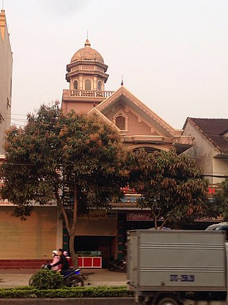 Vinh - A typical house in Vinh, with dome and taijitu sign