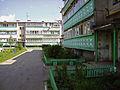 Volodarsk. Noon shadow at blockyard at 1st May Street.jpg
