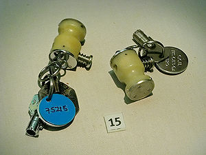 WE.177 - WE.177 safety and arming keys.  The large white plastic part is the tool used to remove the protective cover from the lock.