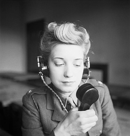 Pte Elizabeth Gourlay transmitting a radio message. War Office Second World War Official Collection H28513.jpg