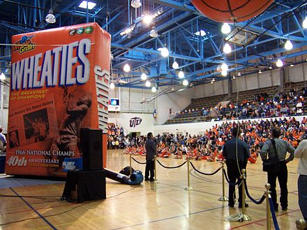 A blow-up model of a Wheaties box to commemorate the opening of Glory Road on the UTEP campus, November 29, 2005. 1966 NCAA basketball championship team members Willie Worsley and Nevil Shedd, are pictured on the box, cutting down the hoop net. Wheaties cheerleaders.jpg