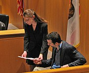 An attorney impeaching a witness during a mock trial competition