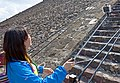 Woman using selfie stick on steps of Pyramid of the Sun, Teotihuacan.jpg
