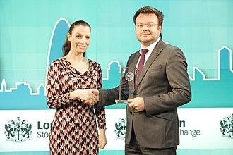 World News Media - A winner from Kazakhstan receiving their award in 2013.