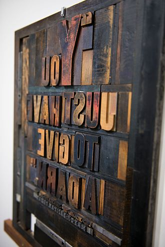 Print design - Metal type blocks arranged for printing with a letterpress