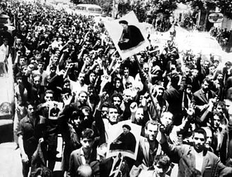 Iranian Revolution - People of Tehran in the demonstrations of 5 June 1963 with pictures of Ruhollah Khomeini in their hands