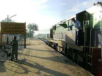 Gudivada - Gudivada station sign board and Machilipatnam Express halted at Gudivada station