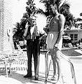 1954 Men talking by the pool.jpg
