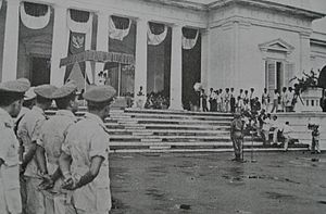 President Sukarno's 1959 Decree - President Sukarno, partly obscured, at top of steps, reading the decree