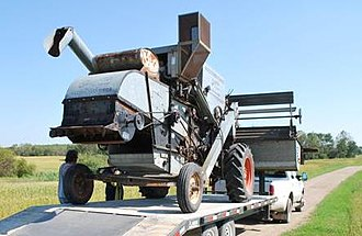 Gleaner Manufacturing Company - A 1965 Gleaner E displaying its ease of loading for over-the-road hauls.