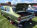 1969 AMC Rebel SST 4-door sedan in green at 2015 AMO show 3of6.jpg