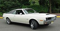 "Shows a white 1970 AMC Javelin with optional black vinyl covered ""halo"" roof and ""Go package"""