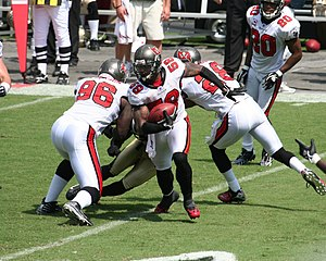 Turnover (gridiron football) - Cato June is shown returning his first regular season interception for the Tampa Bay Buccaneers on September 16, 2007.