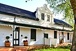 These two Victorianised houses, which were originally erected during the first half of the 19th century, together with six other similar buildings, form one of the most charming and harmonious street scenes in Stellenbosch.
