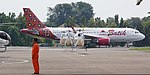 3 TNI-AU Eurocopter EC-120 Colibris hovertaxiing to the hangars give way to a Batik Air Airbus A320.jpg