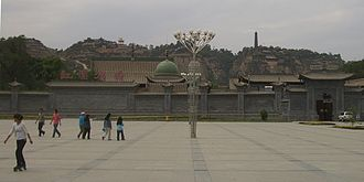 Islam during the Qing dynasty - The dome of Qi Jingyi's Gongbei (shrine) seen over the wall of Hongyuan Park in Linxia