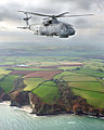 A Merlin HM Mk1 helicopter from 829 Naval Air Squadron, based at RNAS Culdrose, flying over the Cornish coastline. MOD 45145975.jpg