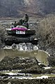 A Republic of Korea (ROK) K 2 Main Battle Tank (MBT) crew take it easy after being taken out by its American counterparts during combined Exercises Reception, Staging, Onward Moveme - DPLA - e2a27f9fd422ce45e4f3d8944fcc321c.jpeg