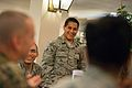 A U.S. Airman, center, laughs as he talks with U.S. Marine Corps Sgt. Maj. Bryan B. Battaglia, left, the senior enlisted adviser to the Chairman of the Joint Chiefs of Staff, during a breakfast with other Airmen 140307-D-KC128-046.jpg