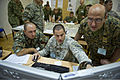 A U.S. Army noncommissioned officer, center, assigned to the Joint Multinational Readiness Center in Hohenfels, Germany, reviews data with a Macedonian soldier, left, and a Bosnian soldier during exercise 130825-A-WB953-113.jpg