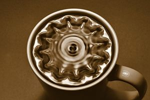 Normal mode -  A flash photo of a cup of black coffee vibrating in normal modes