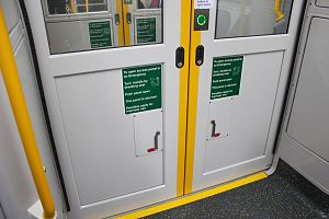 Sydney Trains A set - The inter-carriage doors feature a new mechanism for opening during an emergency, in response to Justice McInerney's Report into the Waterfall rail accident recommending the development of alternative emergency exits for passengers