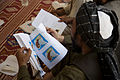 A staff member with an Afghan directorate of agriculture, irrigation and livestock looks at a handout during a veterinary class conducted by U.S. Service members with Georgia Agribusiness Development Team III 130424-M-QZ858-300.jpg