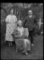 Albert Percy Godber, his wife Laura Godber, and their daughter Phyllis in their garden at Silverstream, probably on the day of Phyllis's wedding ATLIB 313171.png
