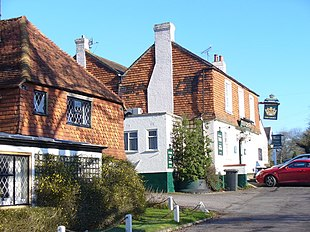 """Old tile-hung cottages and Crown Inn<br class=""""prcLst"""" /> at the centre of Alfold"""