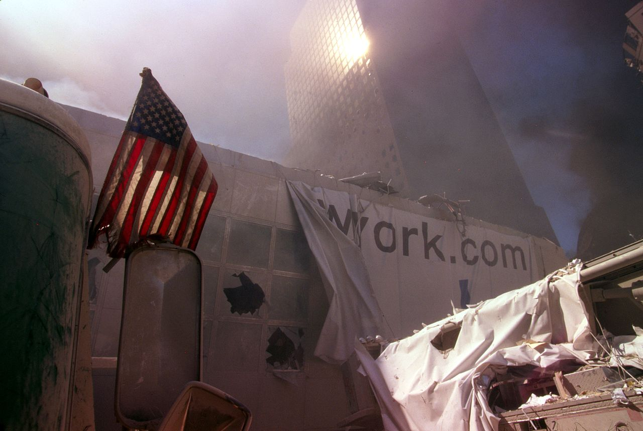 American flag amid rubble following September 11th terrorist attack (29346763401).jpg