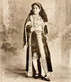 An Indian lady in Victorian Mughal costume (c. 1890).jpg