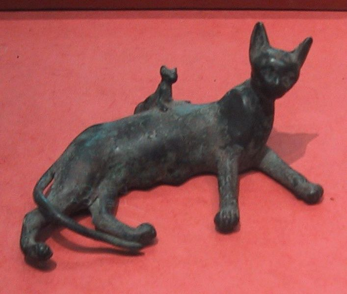Ancient Egyptian bronze statue of a reclining cat and kitten