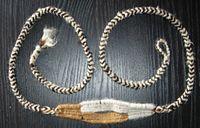 Um tipo de arma peruana (lan�adeira), feita de p�los de alpaca.
