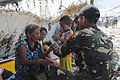 Armed Forces of the Philippines Airman 2nd Class Rj Herrera hands out food to displaced personnel during Operation Damayan at Tacloban Air Field Nov. 16 131116-M-DG262-008.jpg