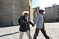 Assisting blind man walking mexico.jpg