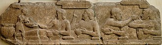 Symposium - Banquet scene from a Temple of Athena (6th century BC relief).