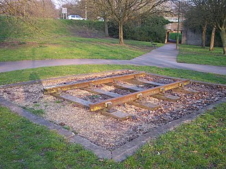 Basingstoke and Alton Light Railway - Section of vintage track representing the   Basingstoke and Alton Light Railway,  on the Viables Roundabout in Basingstoke.