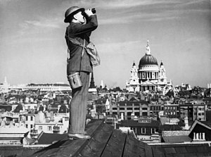 RAF Bentley Priory - Observer Corps aircraft spotter in central London during World War II, stood on a Fleet Street rooftop with St Paul's Cathedral in the background.