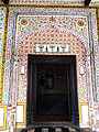 Beautiful wall fresco work on Entrance of Gurdwara Guru Singh Sabah Saidhpur Village Islamabad.jpg