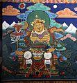 Bhutan-Paro-Dzong-118-Weltenhueter Nord Vaishravana mit Rundbanner und Manguste-gje.jpg